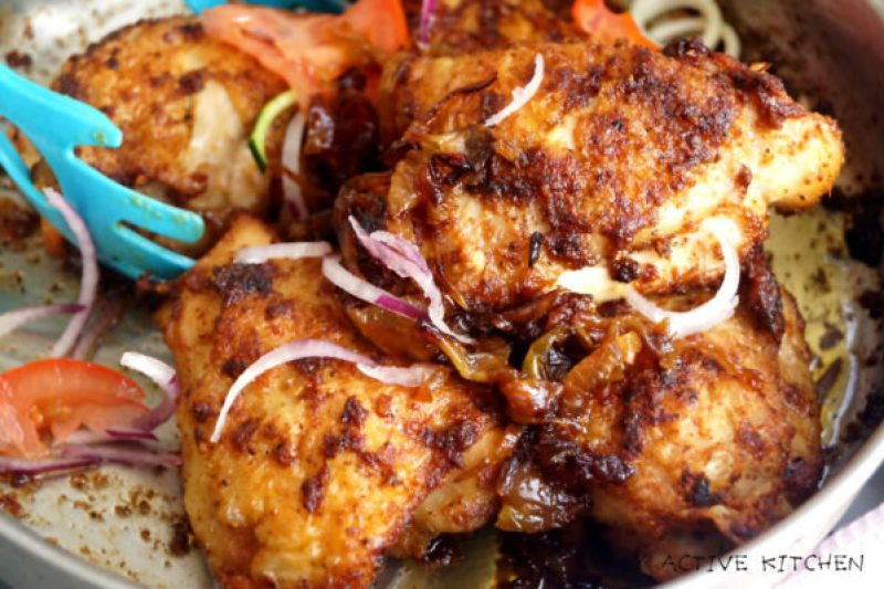 baked chicken suya in a skillet.