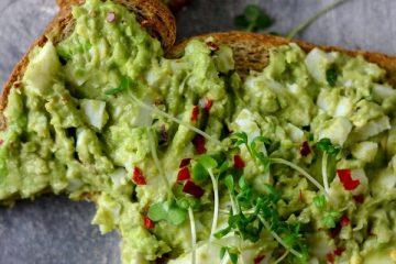 avocado egg salad made with avocado, eggs, herbs, salt and pepper