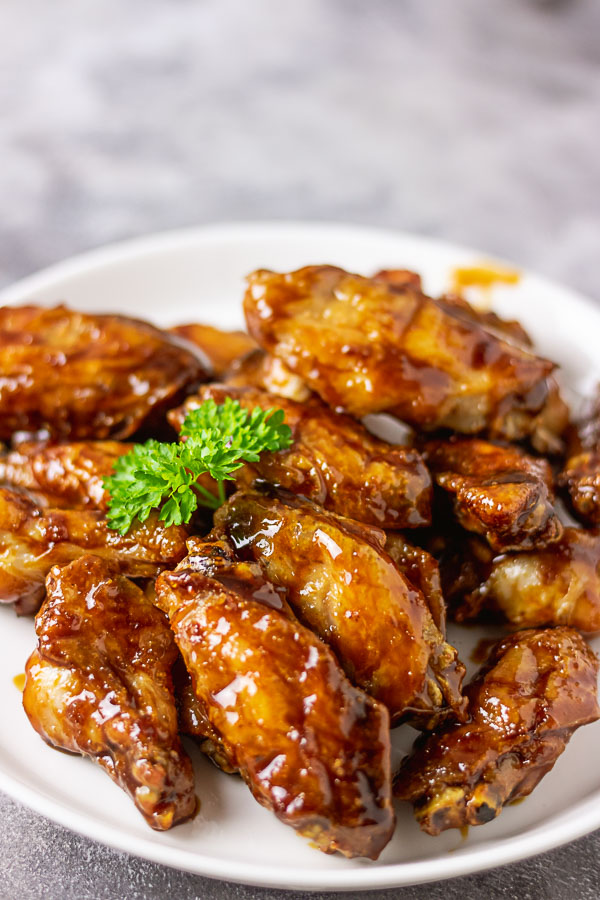 crispy and sticky asian chicken wings! this is an all rounder chicken recipe for all occasions, coated in honey, garlic and soy sauce, this sticky chicken wings is very easy to make too. via myactivekitchen.com