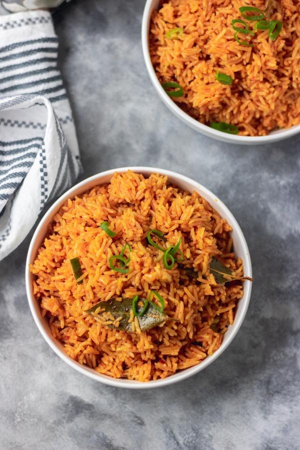 overhead shot of jollof rice with a garnish of bay leaf