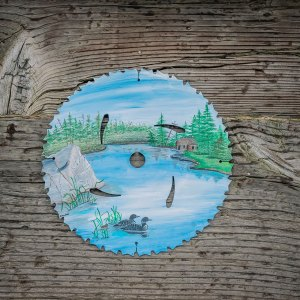 Round Saw Blade with Wilderness Scene and Cabin