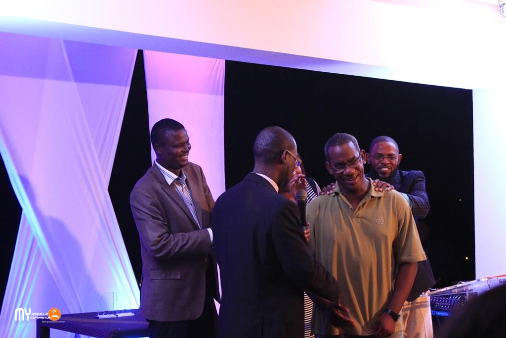 Bren Romney (DYC), Jerome Roberts (Minister of Social Development), Andre Samuel and Kasseem Forde