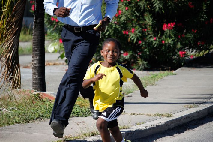 Child running with his father