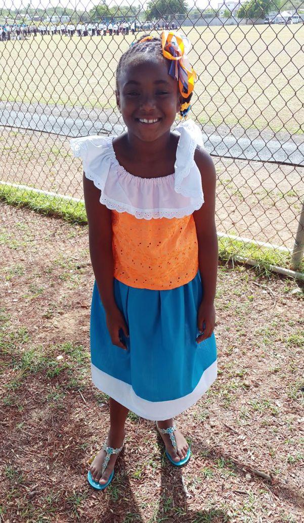 Anguilla Day 2015 Parade. Cute girl wearing Anguilla colours.
