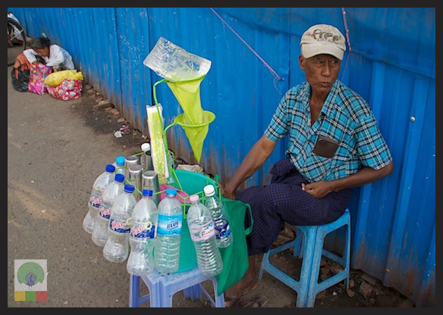 Quick Stop for a Glass of Cold Water on the Streets of Myanmar