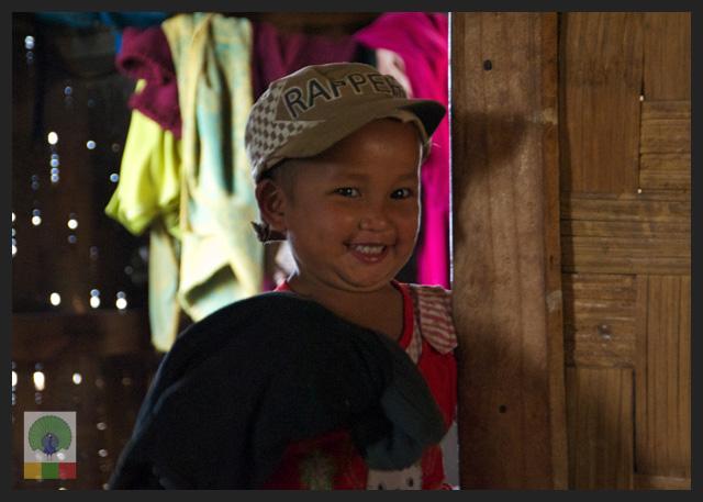 Smiles - Burmese girl at her house - Mountains North Inle Lake - Myanmar (Burma)