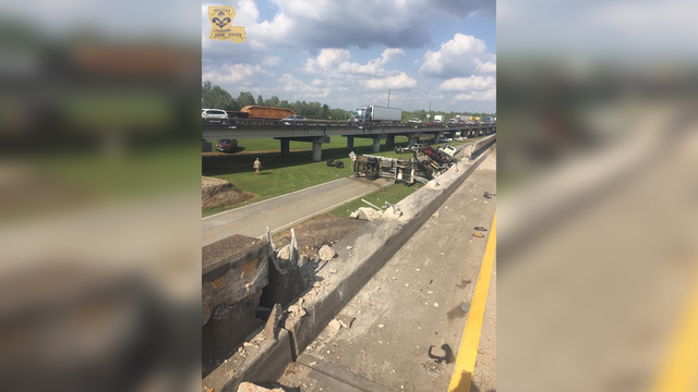 18 wheeler flips off bridge_1490800986594.jpg