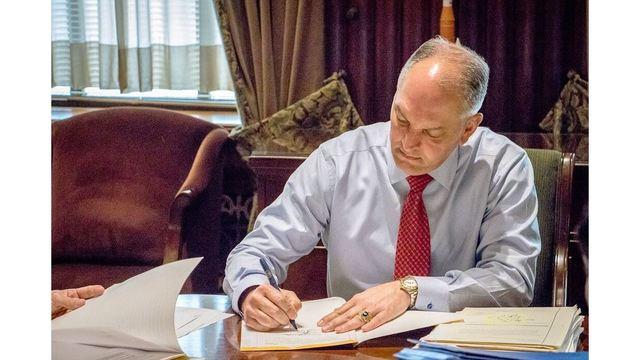 governor edwards signing_1537453395574.jpg.jpg