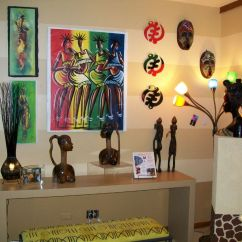 Afrocentric Living Room Ideas Budget Furniture African Decor With Statuettes And Masks