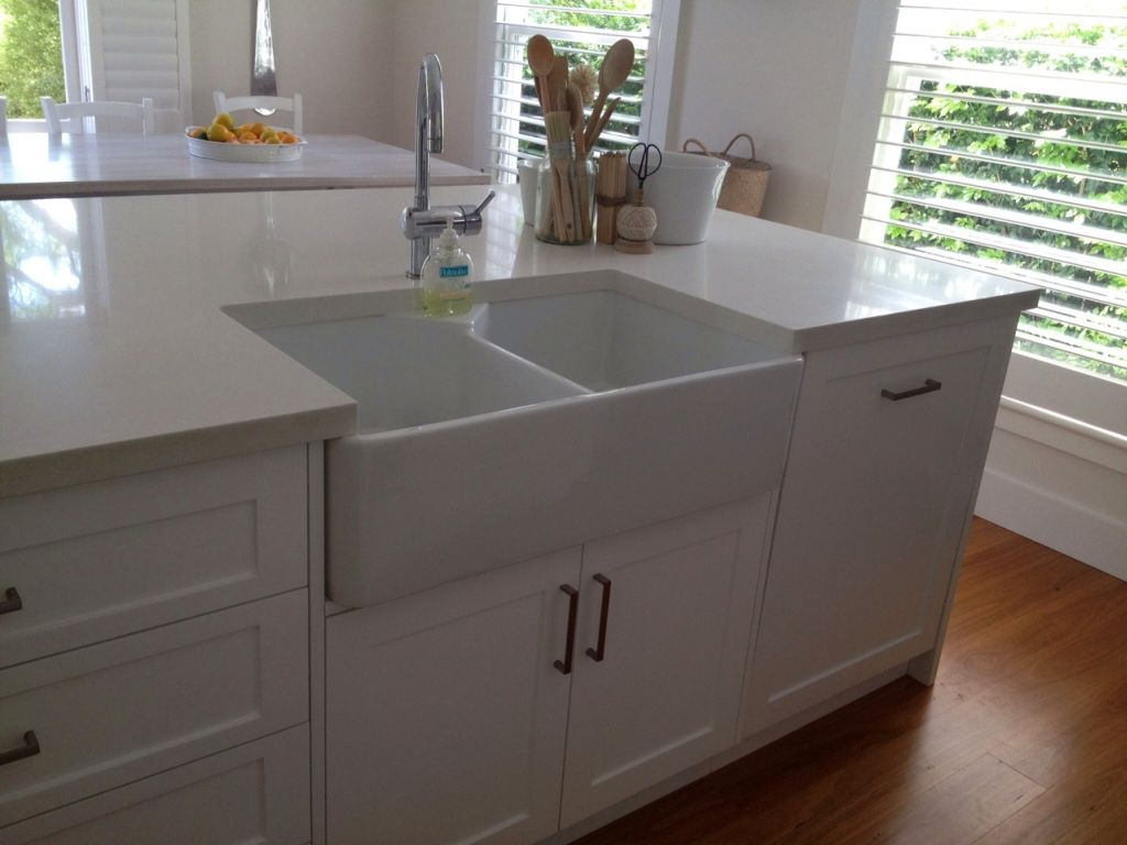 simple kitchen island table and corner bench close up on with sink