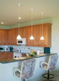 low hanging mini pendant lights over kitchen island for an ...