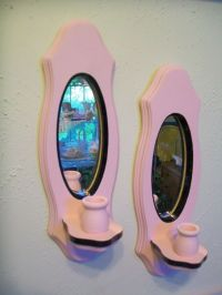mirror candle place pink and black wall decor