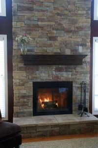 modern fireplace designs with glass and floating shelf