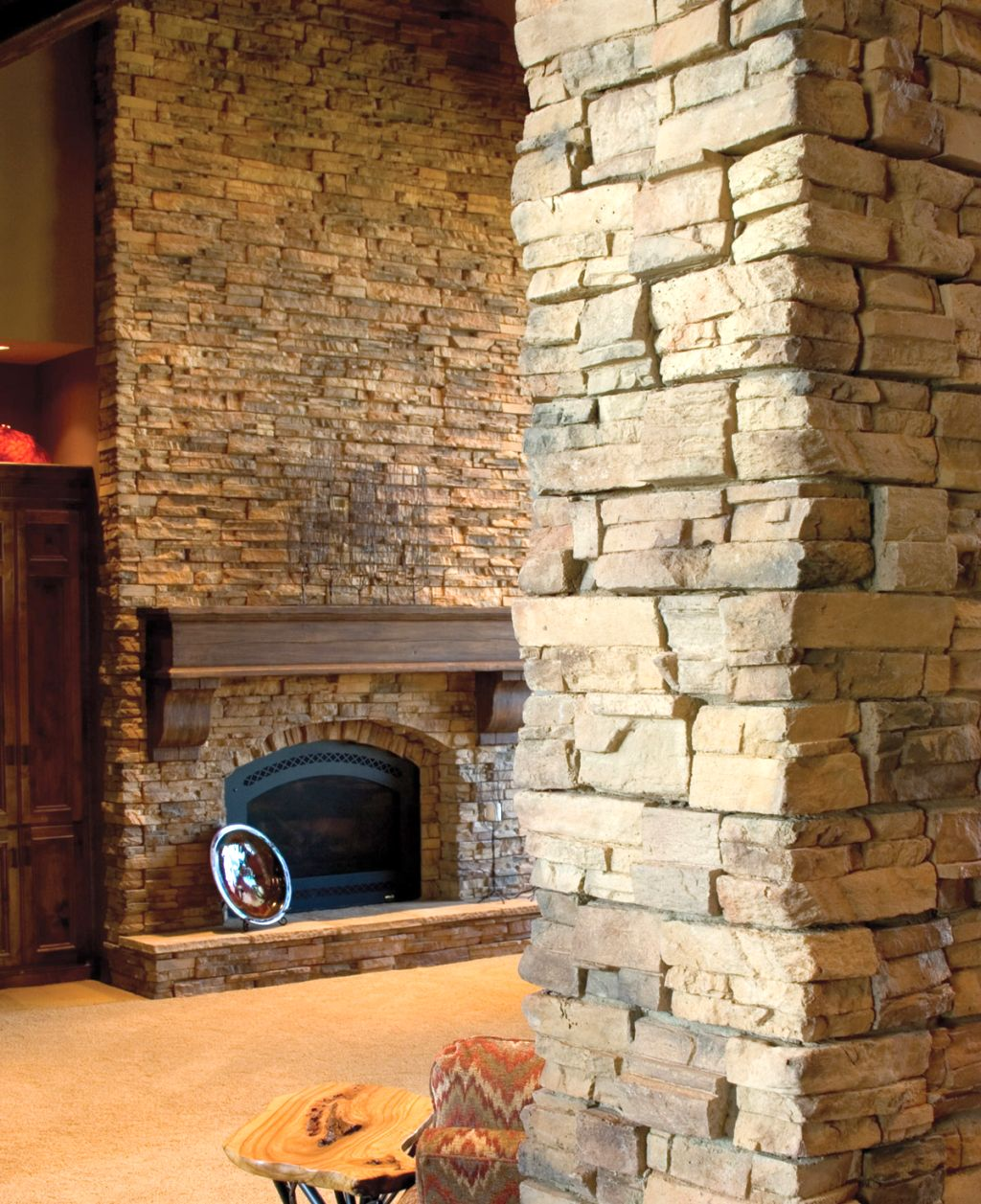 stack stone fireplaces behind the pillar