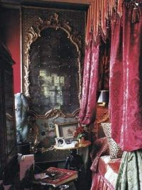 Gothic bedrooms with red canopy curtain