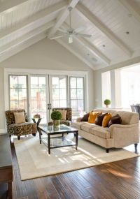cathedral ceiling living room with white ceiling fan