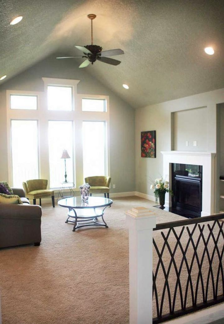 minimalist cathedral ceiling living room with ceiling fan