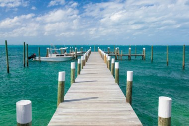 Dock and Boat in Abaco Island, Bahamas.