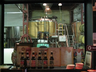 A view from the Great Divide tap room into the brewhouse