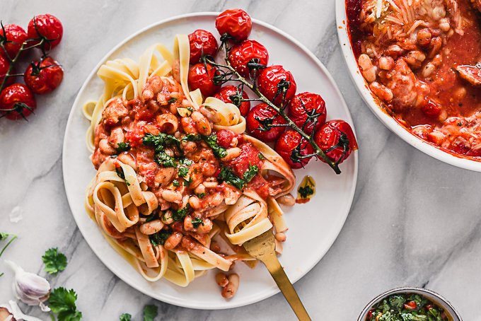 Tomato baked white beans with vegan feta and chimichurri