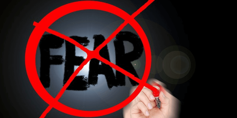 Word fear circled in red and xed out