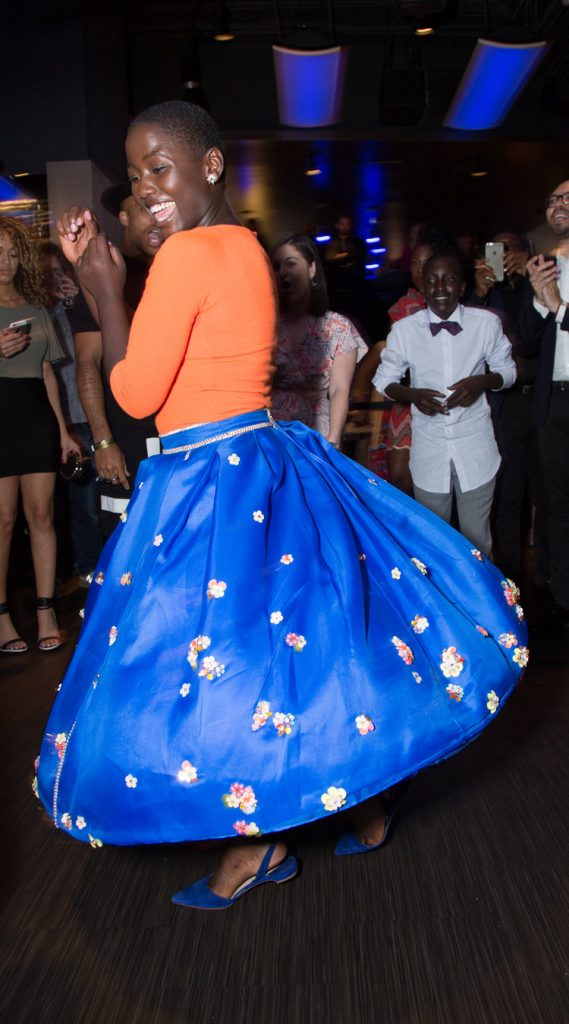 Madina Nalwanga dances at the U.S. premiere of DisneyÕs ÒQueen of KatweÓ at the El Capitan Theatre in Hollywood, CA on Tuesday, September 20, 2016.  The film, starring David Oyelowo, Oscar winner Lupita NyongÕo and newcomer Madina Nalwanga, is directed by Mira Nair and opens in U.S. theaters in limited release on September 23, expanding wide September 30, 2016...(Photo: Alex J. Berliner/ABImages)
