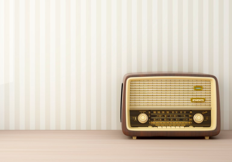 Retro radio in striped painted background