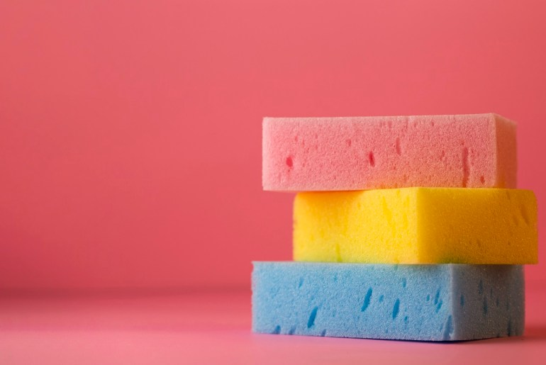 Three sponges (red, yellow, blue) stacked on each other