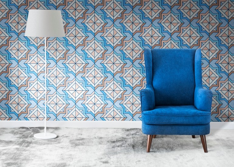 A living room wall with geometric wall patterns