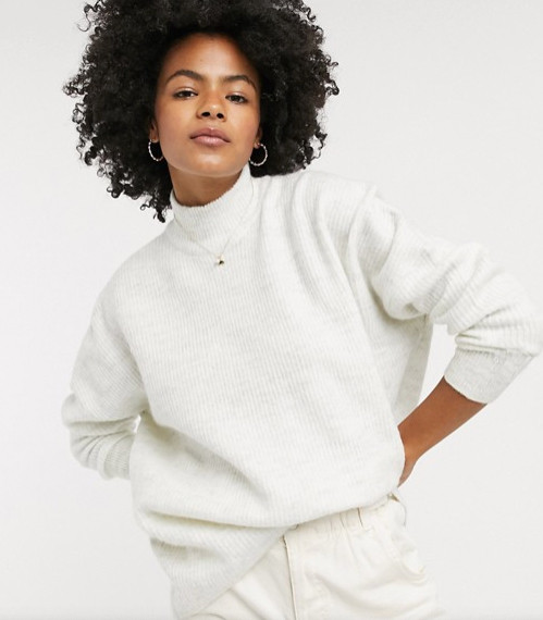 A model wearing a white jumper from Asos.