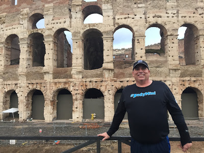 Me next to the Colosseum in Rome.