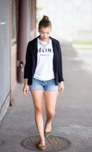 Fashion blogger wearing a celine shirt, black blazer, jean shorts, statement necklace, and leopard flats. Ideas on how to style an outfit with a celine tshirt.
