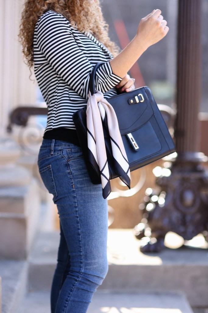 silk scarf tied on handbag