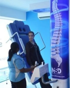 women getting spinal decompression therapy via the RxDecom