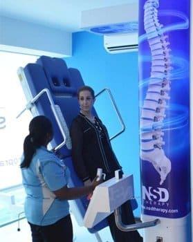 lady getting RxDecom treatment for slip disc in Kuala Lumpur