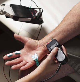 Nerve conduction tests by a neurologist for carpal tunnel syndrome
