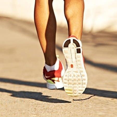 man walking wearing athletic shoe