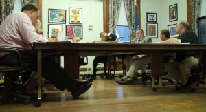 The board of education discussed three options for cutting costs at Tuesday night's meeting. Above, the board deliberates the budget in August.