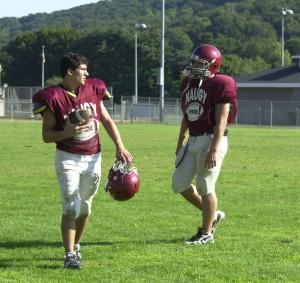 "Naugatuck quarterback Erich Broadrick (left) is putting the NVL on notice: ""Naugatuck's back,"" he says."