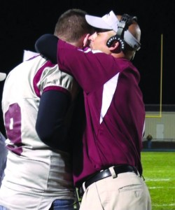 After the Hounds upset Seymour last week, head coach Rob Plasky and senior captain Mike Kennedy shared a moment on the sideline.
