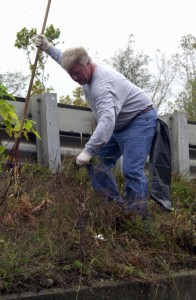 Republican Burgess Bob Neth lends a hand Saturday at the first volunteer Union City Cleanup day. About 300 bags of litter were collected and flower planters were revamped in the area.