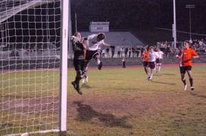 Watertown keeper Josh Acuna snatches away the ball from Naugatuck's Tiago Martins during the teams' 1-1, double-overtime draw Monday night.