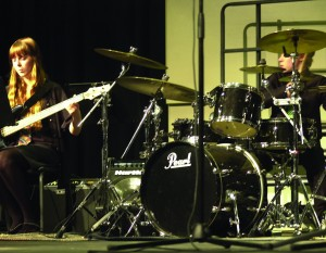 Electric bassist Samantha Schwind and percussionist Jameson stock hold down the rhythm section in a jazz ensemble performance at Woodland's Fall Fine Arts Night Tuesday.