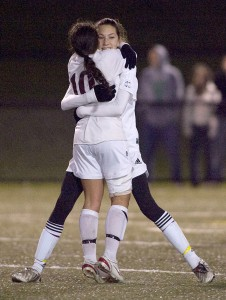 Stephanie Santos (10), Christina Sendra and the Greyhounds are on to the Class L quarterfinals but not without a stiff test against North Haven.