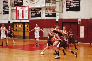 Naugatuck's Julia Longo makes a left-handed drive while Lauren Piroscafo sets the screen during the Greyhounds' 44-41 loss at Torrington Friday.