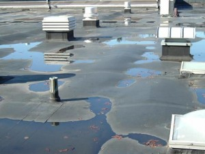 The Long River Middle School roof's drainage system no longer works effectively, leaving puddles of water that often leak into the building. The Region 16 Board of Education hopes voters will approve a $1.9 million renovation at a March 30 referendum.