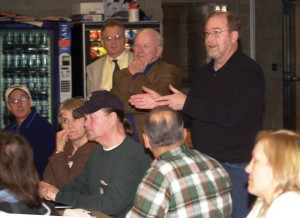 Beacon Falls Selectman Mike Krenesky speaks at Tuesday night's public forum on the Naugatuck River Greenway. State Sen. Joseph Crisco (standing, hand on chin) and others listen.