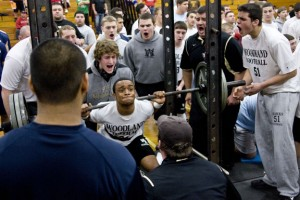 Chris Williams squats 330 pounds, while being spotted by teammate Ian Bures.