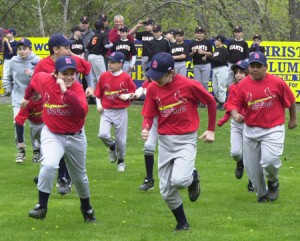 The defending major boys' champion Cardinals take the field during PJF's opening ceremony Sunday.