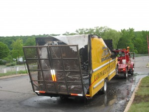 The truck caught fire when a worker attempted to refuel a lawn mower inside of it.